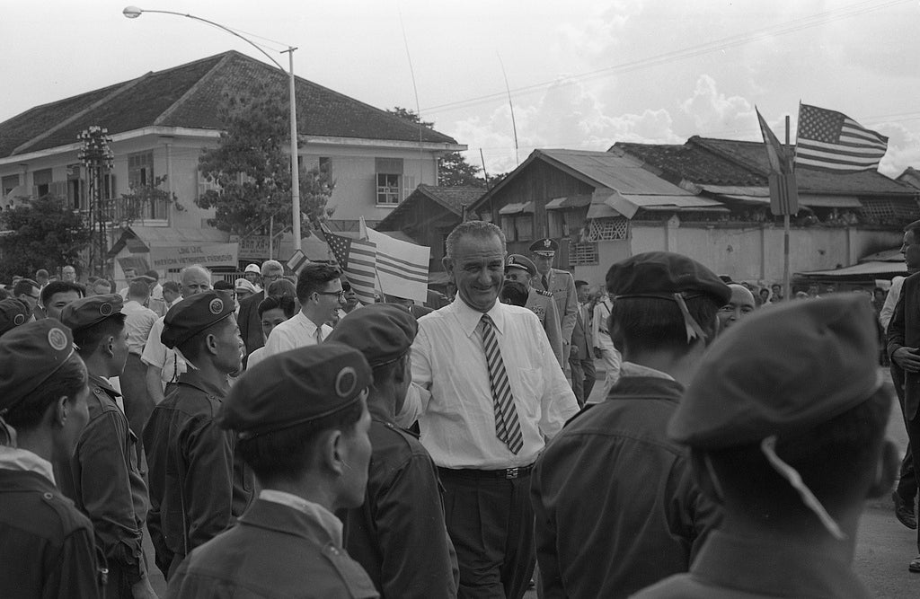 Vice-President Lyndon B. Johnson stands among a group of Vietnamese soldiers and Americans during a visit to Saigon, South Vietnam in the sixties.(Photo: Library of Congress)