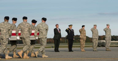 Defense Secretary Ash Carter and Army Chief of Staff Gen. Mark A. Milley  honor Master Sgt. Joshua L. Wheeler, killed during a commando raid in Iraq,  as his body arrives Oct. 24 at Dover (Del.)  Air Force Base. (Photo: Department of Defense/Sipa USA/Newscom)