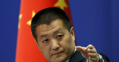 Chinese Foreign Ministry spokesman Lu Kang points out a reporter to receive a question at a regular news conference in Beijing Oct. 27. The U.S. Navy sent a guided-missile destroyer close to China's man-made islands in the disputed South China Sea on Tuesday. (Photo: Kim Kyung-Hoon/Reuters/Newscom)