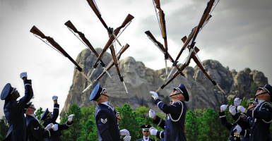 The U.S. Air Force Honor Guard Drill Team performs in front of the Mount Rushmore monument. (Photo: 1st Lt. Nathan Wallin/ZUMA Press/Newscom)