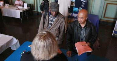 Job seekers talk with a recruiter during a job fair  in San Francisco, Calif. (Photo: Justin Sullivan/Getty Images)