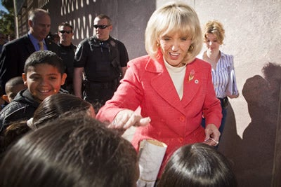 Arizona Gov. Jan Brewer greets elementary school students