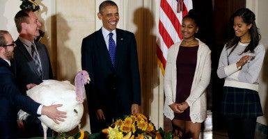 Hopefully, President Obama won't make his family talk politics this Thanksgiving. (Photo: Gary Cameron/Reuters/Newscom)