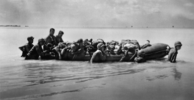 Wounded Marines in rubber boats are towed to larger vessels for transport to base hospitals. There were among the 2,296 wounded in the Battle of Tarawa against the Japanese, Nov. 20-23, 1943. (Photo: Everett Collection/Newscom)