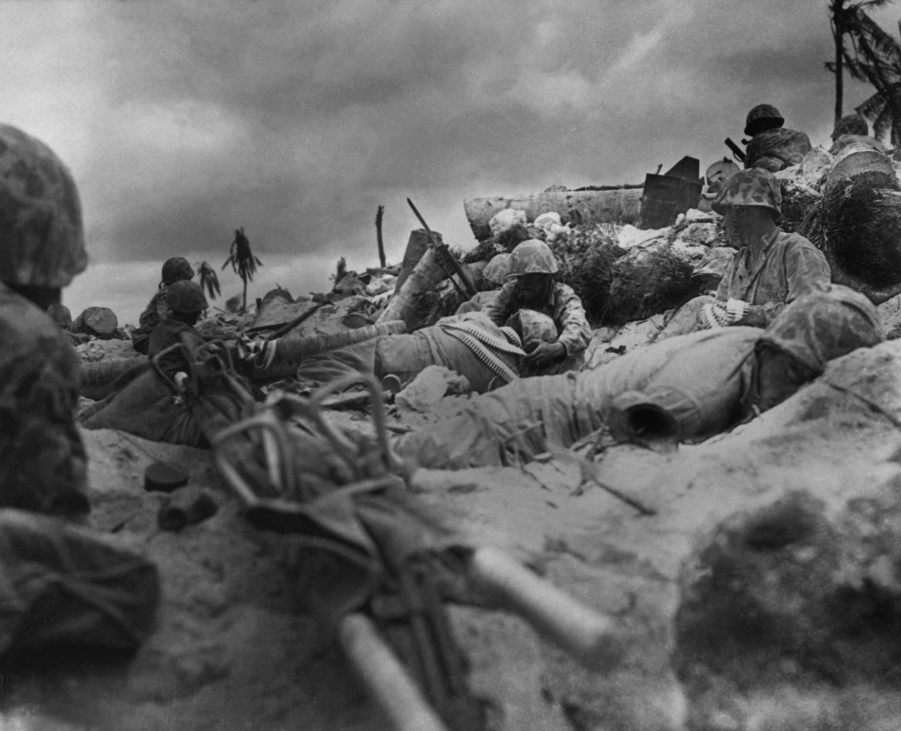 U.S. Marines take cover from Japanese fire behind a sea wall on Red Beach #3, Tarawa Island. Nov. 20, 1943.  (Photo: Everett Collection/Newscom)