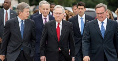 "House conservatives complain that Senate Majority Leader Mitch McConnell, center, introduced a short-term spending bill that does more harm than good. House Speaker Paul Ryan, over McConnell's left shoulder, had predicted ""low drama."" (Photo: Michael Reynolds/EPA/Newscom)"