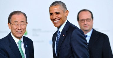 United Nations Secretary General Ban Ki-moon shakes hands with President Barack Obama as French president Francois Hollande looks on as Obama arrives for the opening of the UN conference on climate change. (Photo: WostokPress/MaxPPP/Newscom)