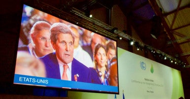 Secretary of State John Kerry addresses delegates from 196 countries after they approved a sweeping environmental agreement during the climate change conference in Paris.(Photo: State Department/Sipa USA/Newscom)