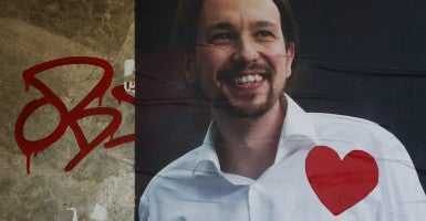 A red heart is pasted on a poster of Podemos (We Can) party leader Pablo Iglesias a day after Spain's election. (Photo: Susana Vera/Reuters/Newscom)