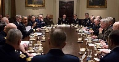 President Barack Obama and Vice President Joe Biden hold a meeting with Combatant Commanders and Military Leadership in the Cabinet Room of the White House.