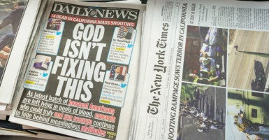 "Talk to a person of faith,  and you'll find that the ""God Isn't Fixing This"" cover is a ""dog bites man"" kind of story. (Photo: Richard B. Levine/Newscom)"