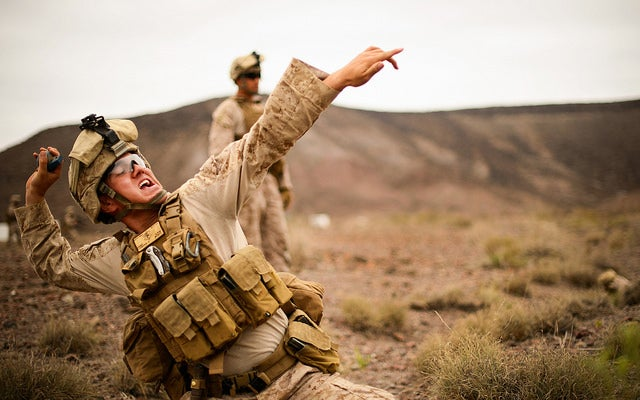 A U.S. Marine with the 13th Marine Expeditionary Unit (MEU), Battalion Landing Team, Alpha Company 1/4, throws a training grenade during a live fire and movement grenade training exercise at Arta Range, Djibou. (Photo: Staff Sgt. Staci Miller/Released)