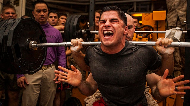 Staff Sgt. Jace Manning squats 385 pounds during a weight-lifting competition aboard the USS Bataan (LHD 5). (Photo: Sgt. Austin Hazard/Released)
