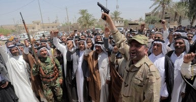 A group of farmers form a brigade to defend Iraq. (Photo: Ali Jassem/Transterra Media/Newscom)