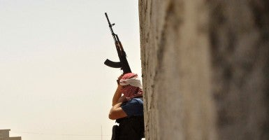 An Iraqi Turkmen fighter holds a position June 25 in the village of Turklan. (Photo: Marwan Ibrahim/AFP/Getty Images)
