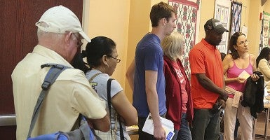 Potential enrollees line up to register for an Obamacare plan in March at a library in Boynton Beach, Fla. (Photo: Damon Higgins/The Palm Beach Post/ZumaPress.com)
