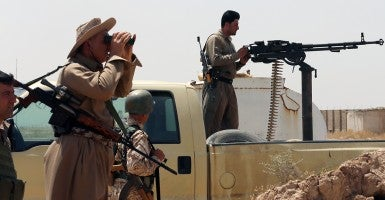 Iraqi Kurdish forces take position June 29  as they fight jihadists from the Islamic State of Iraq and Syria (ISIS) in the Iraqi village of Bashir. (Photo: AFP/Newscom)
