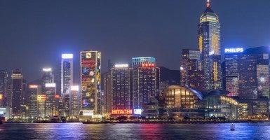 A view of downtown Hong Kong, China at night (Newscom).