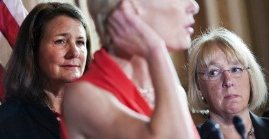 "Sen. Patty Murray, D-Wash., right, and Rep. Diana Degette, D-Colo., listen to Cecile Richards, president of Planned Parenthood, speak at a news conference in the Capitol, July 9, 2014, on legislation ""to protect women's health"" after last week's Supreme Court decision waiving ruling that the government cannot force Hobby Lobby to provide health care coverage of abortion-inducing drugs and devices. (Photo: Tom Williams/CQ Roll Call/Newscom)"