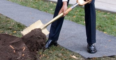 President Barack Obama uses a shovel during a commemorative tree planting on the North Lawn of the White House. (Photo: Saul Loeb/AFP/Getty Images)