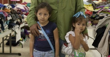Two Salvadoran children, ages 5 and 9, at the Catholic Charities center in Mcallen, Texas. New reports say hundreds of undocumented children may be headed from the Mexican border to Wisconsin. (Photo: Xinhua/Marcus DiPaola)