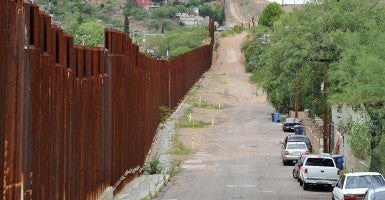 The border fence between the United States and Mexico stretches to the west near Nogales, Arizona. (Photo: UPI/Art Foxall/Newscom)