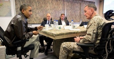 President Obama receives a briefing from Gen. Joseph F. Dunford, Jr., Commander of International Security Assistance Force and United States Forces-Afghanistan, at Bagram Airfield, Afghanistan, Sunday, May 25, 2014. (Photo: Pete Souza/White House/Sipa USA)