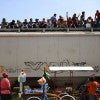 Central American immigrants sit atop La Bestia (The Beast) cargo train, in an attempt