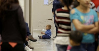 A toddler sits on the floor with other unaccompanied minors at a U.S. Customs and Border Protection processing facility in Brownsville, Texas. (Photo: Polaris/Newscom)