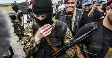 Armed pro-Russian separatists block the way to the crash site of Malaysia Airlines Flight MH17, near the village of Grabove, in the region of Donetsk on July 20, 2014.  The missile system used to shoot down a Malaysian airliner was handed to pro-Russian separatists in Ukraine by Moscow, the top US diplomat said Sunday. (Photo: AFP/Bulent Kilicbulent Kilic/Newscom)