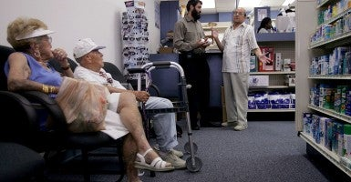 Seniors wait for medication at a Florida pharmacy. (Photo: Joe Raedle/Getty Images)