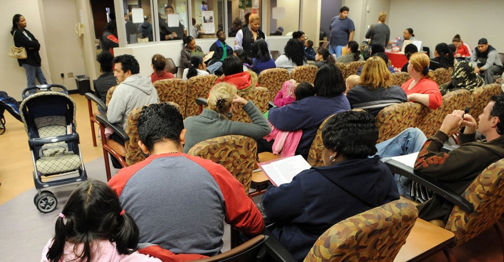 People wait in line to apply for benefits at the Gwinnett County Department of Family and Childrens Services.This office has been so overwhelmed by applicants that the fire marshall had to close it down one day. (Photo: © Erik Lesser/ZUMAPRESS.com)