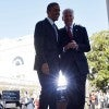 President Obama walks back to the Oval Office with Vice President Joe Biden after he delivered a statement on the Affordable Care Act at the Rose Garden of the White House in Washington, DC, on April 1, 2014. (