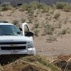 A member of the US Border Patrol watches the border line between El Paso in the U