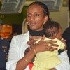 Meriam Ibrahim Ishag, with daughter Maya, at Rome's Fiumicino Airport on the way to the United States. (Photo: Newscom)