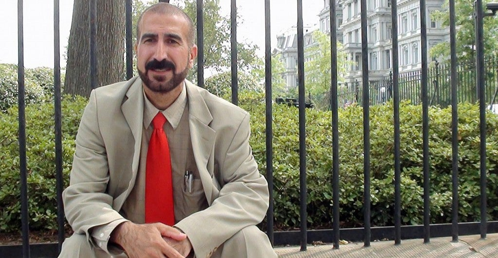 Mirza Ismail, chairman of the Yezidi Human Rights Organization, sits outside the White House awaiting a meeting with Obama administration national security officials. (Photo: Kelsey Harkness/The Daily Signal)