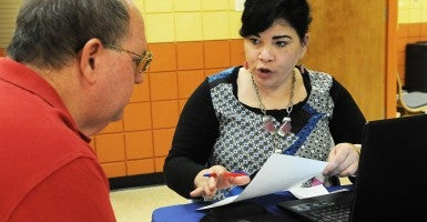 Obamacare navigator Nilda Acosta helps Richard Delph sign up for health insurance under the Affordable Care Act.(Photo: Polaris/Newscom)