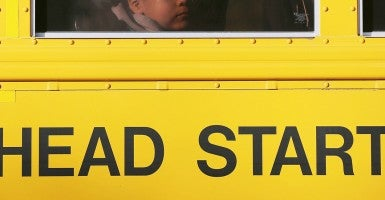 Students on bus to a federally funded Head Start program. (Photo: John Moore/Getty Images)