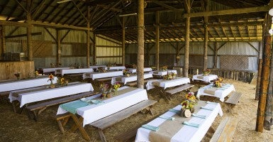 A barn wedding reception. (Photo: Joshua Rainey Photography)