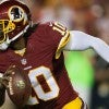 Washington Redskins quarterback Robert Griffin III scrambles for yardage against the Cleveland Browns in the first half of their Aug. 18 preseason game at FedEx Field in Landover, Md.(Photo:Harry E. Walker/ZUMA Wire)