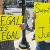 A crowd of about 150 gathered July 22 at Lynn City Hall to voice both concern about and support for illegal immigrants. (Phot
