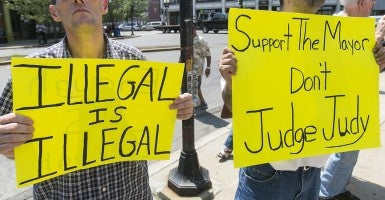 A crowd of about 150 gathered July 22 at Lynn City Hall to voice both concern about and support for illegal immigrants. (Photo: Marilyn Humphries/Newscom)