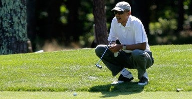 President Obama lines up a putt on the first green at the Farm Neck Golf Club in Oak Bluffs, Mass., last month. (Photo: Matthew Healey/Newscom)