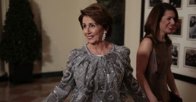 House Minority Leader Nancy Pelosi, a Democrat from California, left, and Jacqueline Kenneally arrive to a fancy state dinner hosted by U.S. President Barack Obama and U.S. First Lady Michelle Obama. (Photo: Polaris/Newscom)