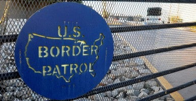 A Border Patrol sign on a fence in the border town of Nogales in Santa Cruz County, Ariz. (Photo: Newscom)