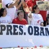 People protest the immigration policies of President Barack Obama outside the White House in late