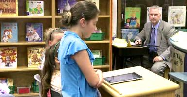 Grace Karaffa presents the petition to the School Board. (Photo: Screengrab via Lynchburg News and Advance video)