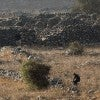 Rebels fighting the Syrian regime take position Sept. 2 near the Israeli-Syrian border. (