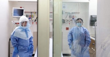 A medical worker wears a protective suit inside an isolation room appropriate to handle people inflected with the Ebola virus at Bellevue Hospital Center in New York, New York. (Photo: Newscom)
