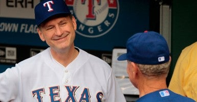 Supreme Court Justice Samuel Alito, a lifelong baseball fan, threw out the ceremonial first pitch at a Texas Rangers game in 2013. (Photo: Ron T. Ennis/Fort Worth Star-Telegram/MCT/Newscom)
